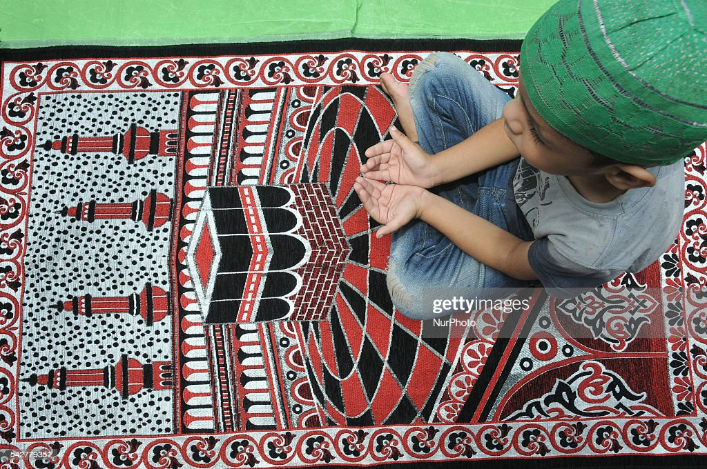 Indian Muslims offering ritual prayer on the Third Friday of Ramadan (also known as Ramadhan or Ramzan) on June 24 2016 at Kolkata.India. Ramadan (also known as Ramadhan or Ramzan) is the ninth month in the Islamic calendar. During the month of Ramadan; Muslims fast from dawn to dusk all over the world. While fasting from dawn until sunset; Muslims avoide from consuming food; drinking liquids; smoking; and engaging in sexual relations.