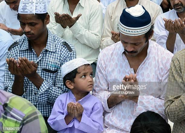 Indian Muslims pray as they gather for JummatUlVida prayers on the last Friday of Ramadan at the historic Jama Masjid in New Delhi on August 2 ahead...