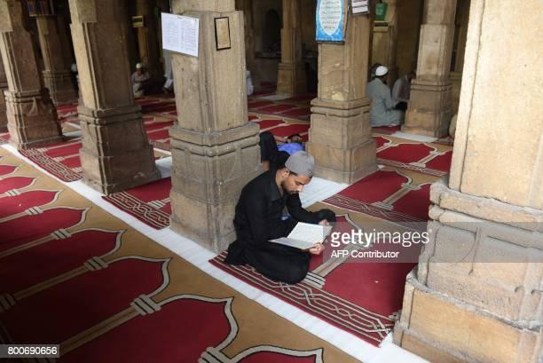 Indian Muslims read inside the Pir Kamal Danilimda Masjid ahead of the Muslim festival of Eid alFitr in Ahmedabad on June 24 2017 Eid alFitr is the...