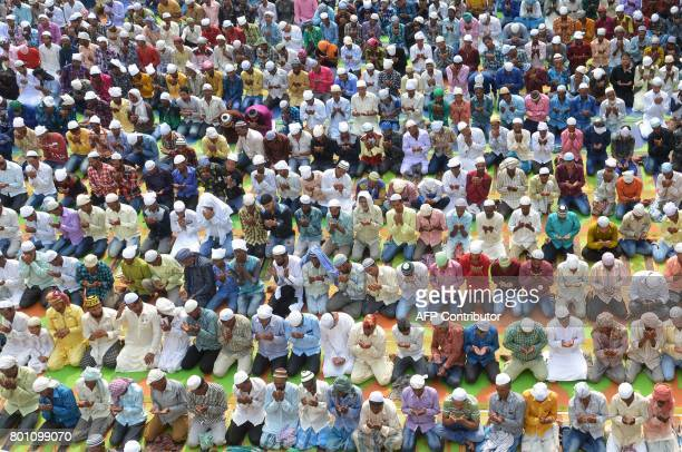 Indian Muslims take part in Eid alFitr prayers at the Khairuddin Mosque in Amritsar on June 26 2017 Muslims around the world are celebrating the Eid...