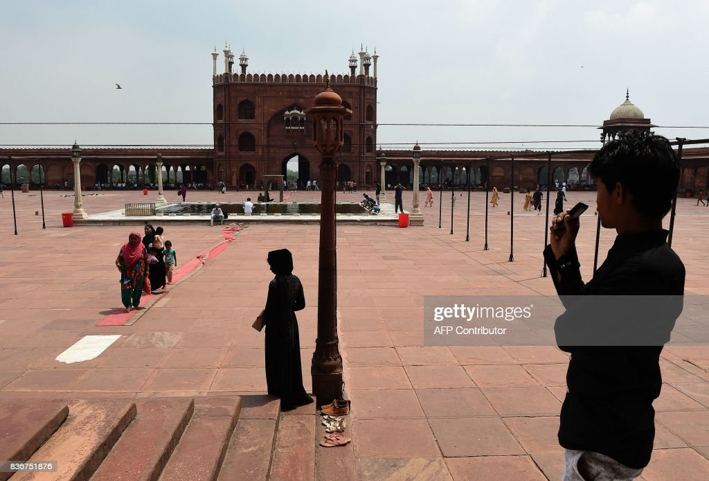 Indian Muslims visit the Jama Masjid mosque in New Delhi on August 22, 2017. India's top court on August 22 banned a controversial Islamic practice that allows men to divorce their wives instantly, ending a long tradition that many Muslim women had fiercely opposed. PHOTO / Prakash SINGH