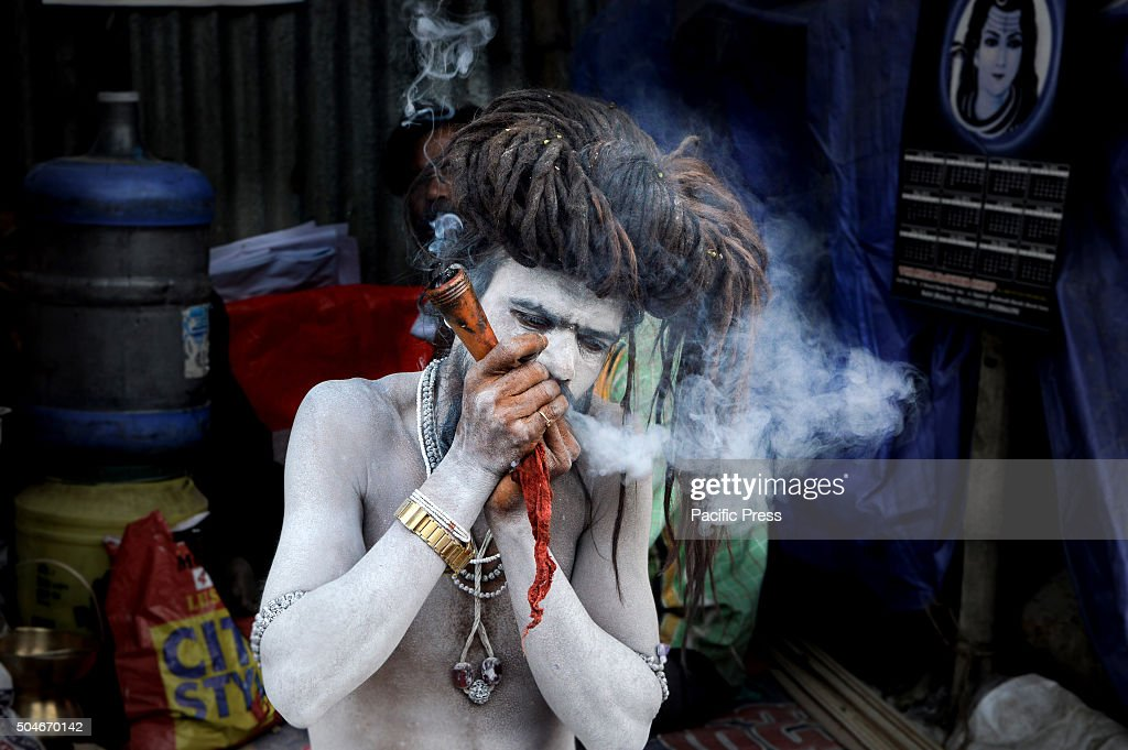 Indian Naga Sadhu smoking chillam in Gangasagar transit ...