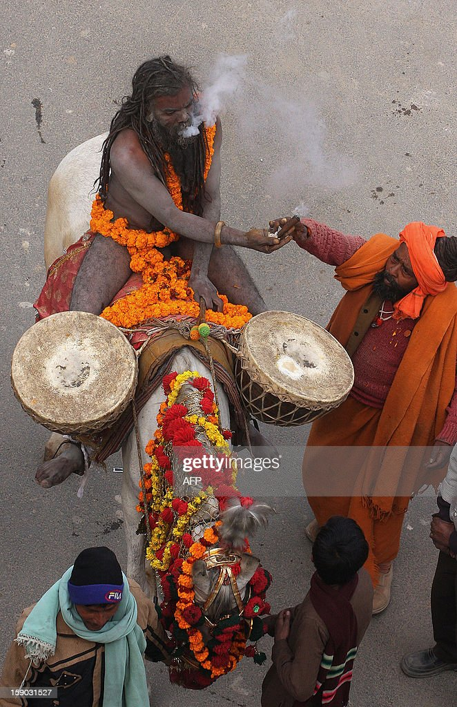 Indian Naga Sadhus - holy men - of Shri Panchayati Anand Akhara participate in a religious procession as the first 'royal entry' for the Kumbh Mela at Sangam in Allahabad on January 6, 2013. The Kumbh Mela, which is scheduled to take place in the northern Indian city in January and February 2013, is the world's largest gathering of people for a religious purpose and millions of people gather for this auspicious occasion. AFP PHOTO/Sanjay KANOJIA