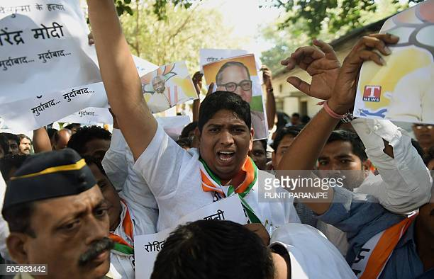 Indian National Congress Party activists take part in a protest after a student found was dead at a university hostel in Mumbai on January 19 2016...