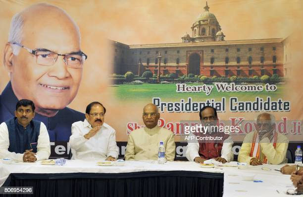 Indian National Democratic Alliance member and government candidate for the forthcoming presidential election Ram Nath Kovind looks on during a...