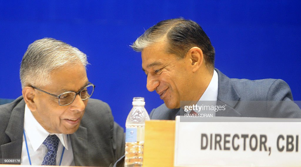 Indian National Security Adviser to the Prime Minister M K Narayanan chats with Central Bureau of Investigation Director Ashwani Kumar at the Central...