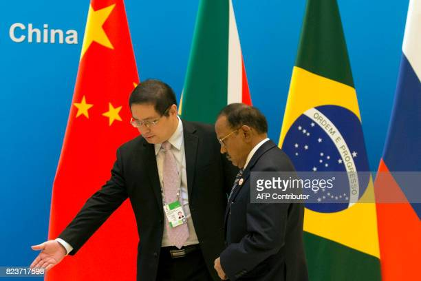 Indian National Security Advisor Ajit Doval is shown the way to this position before the seventh meeting of BRICS senior representatives on security...