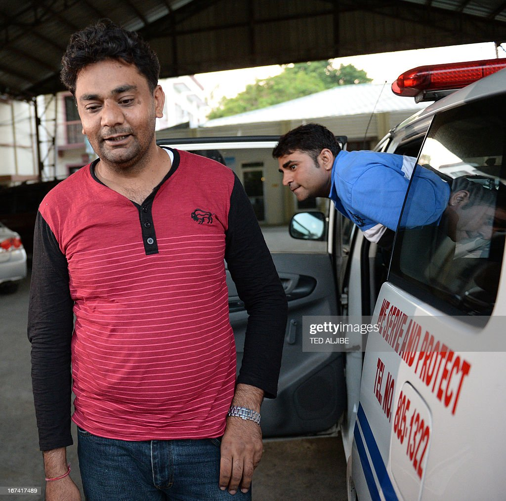 Indian nationals and Narinder Singh (L) and Rajesh Kumar arrive at the police station for enquiries in Alaminos town, Laguna province, south of Manila on April 25, 2013, after a powerful explosive device was found inside an Indian businessman's car. Philippine police have recovered a powerful explosive device inside an Indian businessman's car, an official said April 25. The three Indian nationals were released later in the day by police for further investigation.
