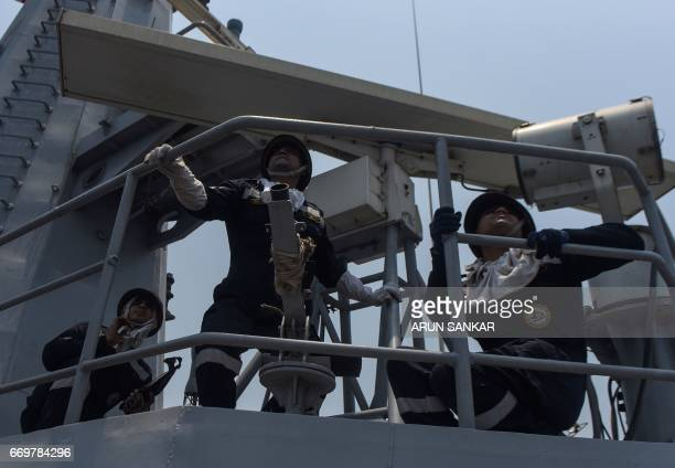 Indian naval cadets prepare for a drill on board India's naval ship INS Sumedha during exercises in the Bay Of Bengal off the coast of Chennai on...