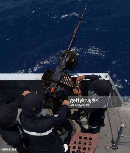 Indian naval cadets prepare for an artillery drill on board India's naval ship INS Sumedha during exercises in the Bay Of Bengal off the coast of...