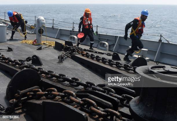 Indian naval cadets take part in a drill on board India's naval ship INS Sumedha during exercises in the Bay Of Bengal off the coast of Chennai on...
