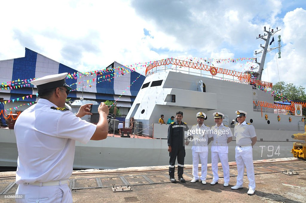 "Indian Navy officer taken pictures her mobile camera at front of The fourth in the series of four ""Water Jet Fast Attack Craft"" (WJFAC) being built for the indian Navy by Garden reach Shipbuilders & Engineers Ltd (GRSE) ceremony at Raja Bagan Dockyard in Kolkata, India, on 30 June 2016."