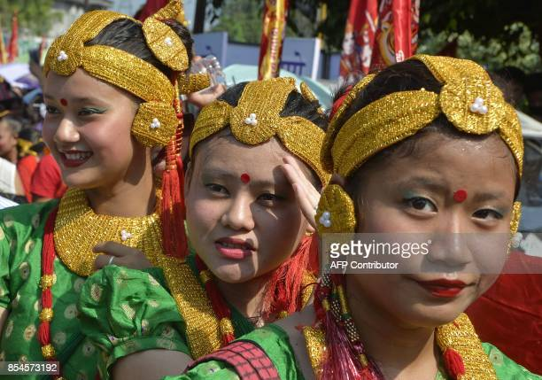 Indian Nepali Hindus celebrate during the Fulpati procession marking the seventh day of the Dasain festival in Siliguri on September 27 2017 The...