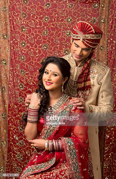 Indian newlywed couple in traditional wedding dress