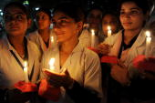 Indian nursing students hold a candlelight vigil on the eve of the World AIDS Day in Amritsar on November 30 2009 The UNAIDS agency says some 25...