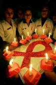Indian nursing students hold a candlelight vigil to mark World AIDS Day in Amritsar on December 1 2008 In the 25 years since the first case was...