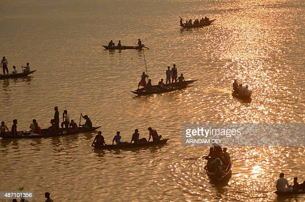 Indian oarsmen row boats during the traditional annual boat race festival at a Rudra Sagar lake in Melaghar 55 kms south east of Agartala the capital...