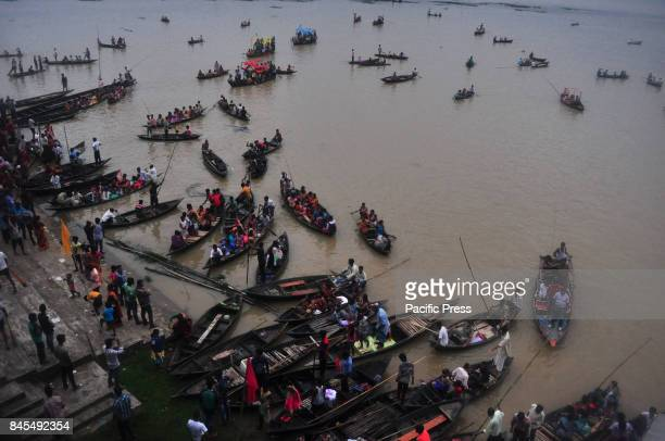 Indian oarsmen row boats during the traditional annual boat race festival at Rudra Sagar lake in Melaghar 55 kms south east of Agartala the capital...