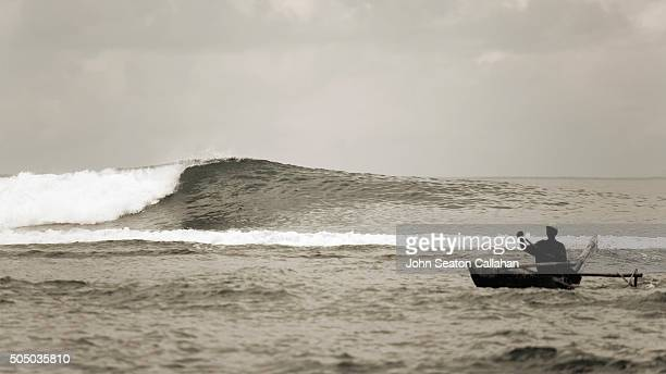 Indian ocean wave and fisherman