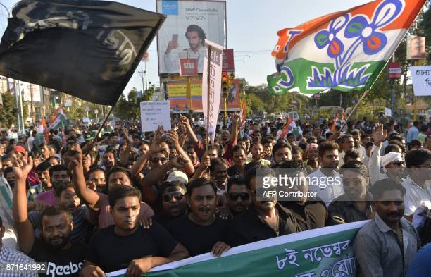 Indian of Trinamul Congress Party supporters shout slogans during a protest rally on the first anniversary of India's demonetisation scheme in...