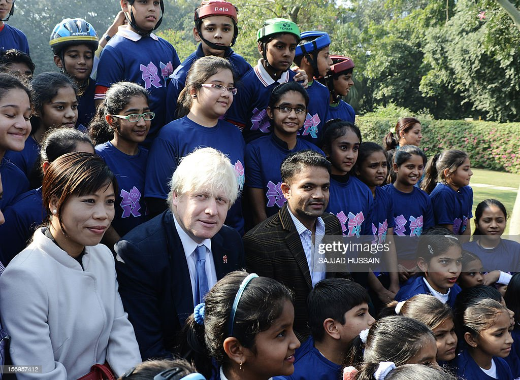 Indian Olympic medallist for boxing Mary Kom (L), Mayor of London Boris Johnson (C), and Indian shooter Vijay Kumar pose for a picture at a function in New Delhi on November 26, 2012. Johnson handed over to India a petal from the London 2012 Olympics cauldron. Boris Johnson is in India on a six day tour in a bid to boost trade with the subcontinent.