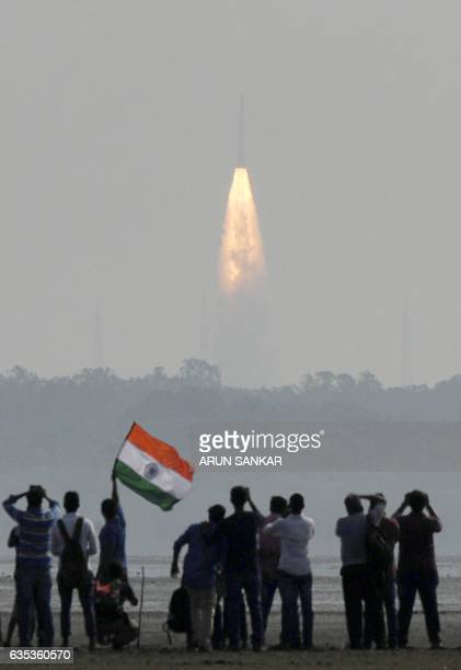 Indian onlookers watch the launch of the Indian Space Research Organisation Polar Satellite Launch Vehicle at Sriharikota on Febuary 15 2017 India...