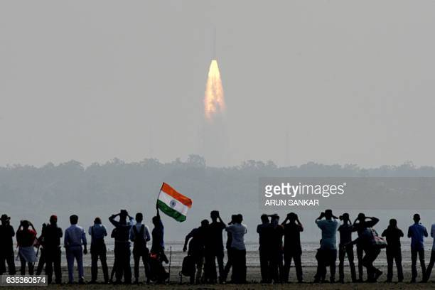 TOPSHOT Indian onlookers watch the launch of the Indian Space Research Organisation Polar Satellite Launch Vehicle at Sriharikota on Febuary 15 2017...