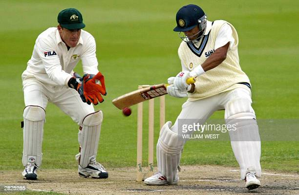 Indian opener Akash Chopra attempts to cut as Australia 'A' wicketkeeper Wade Seccombe looks on during their match in Hobart 21 December 2003...