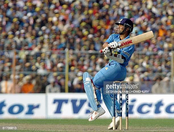 Indian opening batsman Sachin Tendulkar plays a shot during the One Day International match at the Eden Gardens Stadium in Calcutta 13 November 2004...