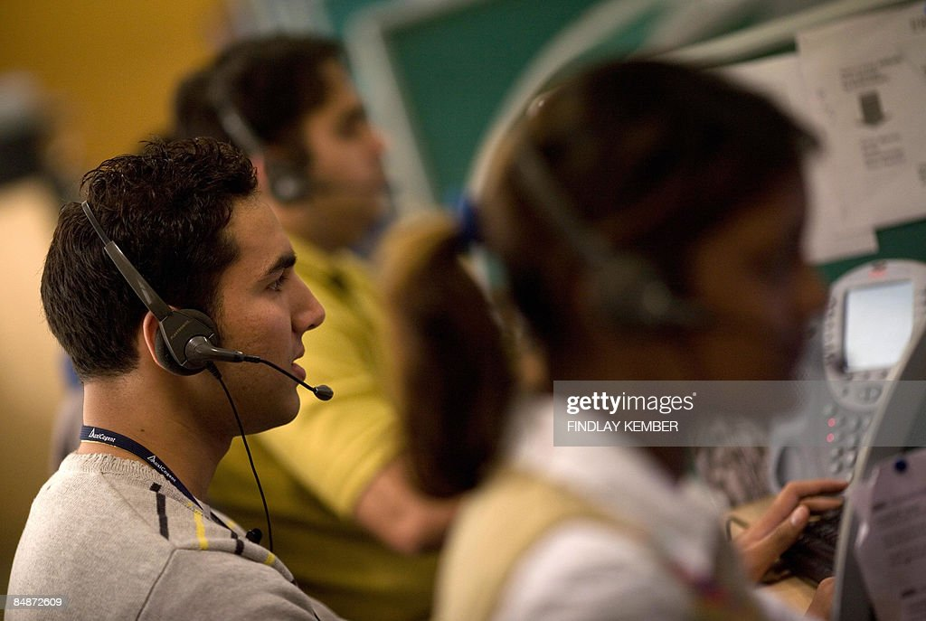 Indian operators take calls at Quatrro call-centre in Gurgaon on the outskirts of New Delhi on December 5, 2008. AFP PHOTO/Findlay KEMBER