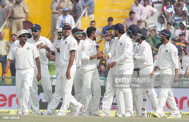 Indian palyer Ravindra Jadeja celebrating with other team players after the dismissal of South Africa Captain Hashim Amla during the third day of...