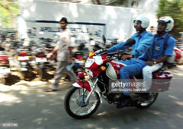 Indian paramedical workers at the Apollo Hospitals ride their twowheeler ambulance after their inauguration at the hospital building premises in...