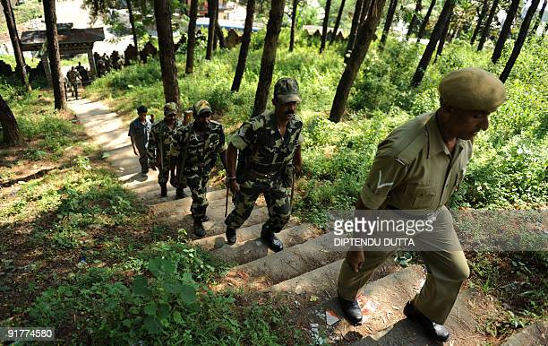 Indian paramilitary forces head to a polling booth from a temporary election distribution cell in Itanagar capital of northeastern Indian state of...