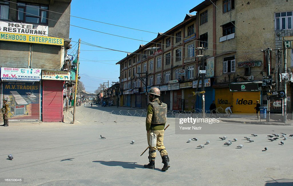Indian paramilitary forces stand guard during a curfew like restriction on March 06, 2013 in Srinagar, the summer capital of Indian Administered Kashmir, India. Indian authorities imposed curfew like restrictions in most parts of Kashmir following a killing of kashmiri youth by Indian army in North Kashmir's Baramulla district yesterday.