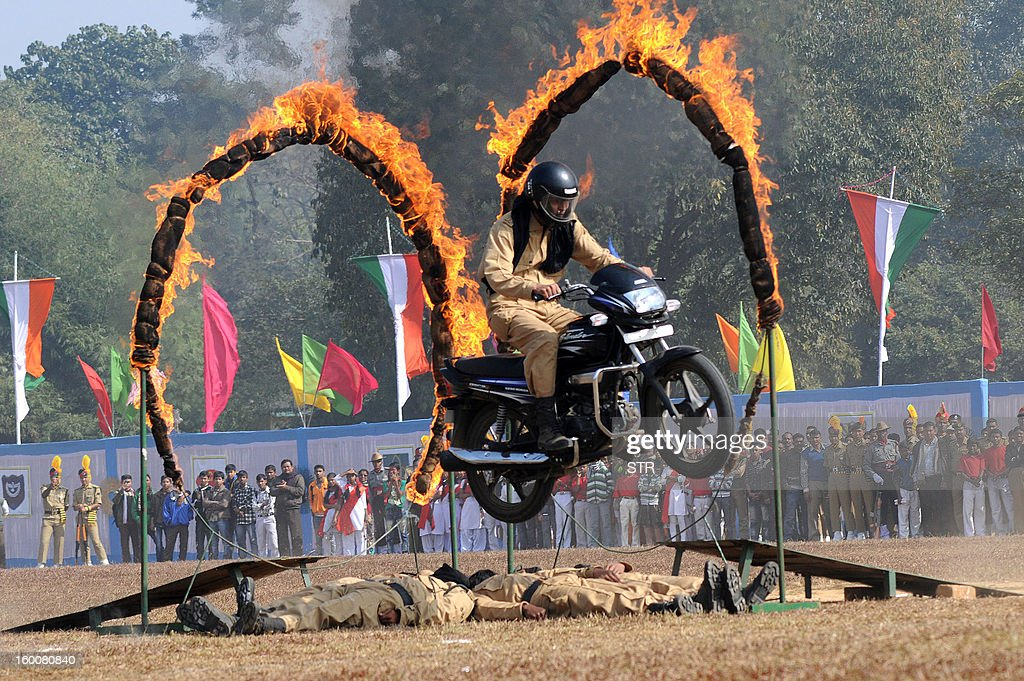 Indian paramilitary security personnel performs a stunt on a motorcycle during Republic Day celebrations at Assam Rifles ground in Agartala, in the northeastern state of Tripura on January 26, 2013. India marked its Republic Day with celebrations held under heavy security, especially in New Delhi where large areas were sealed off for an annual parade of military hardware at which Bhutan's king Jigme Khesar Namgyel Wangchuck was chief guest.