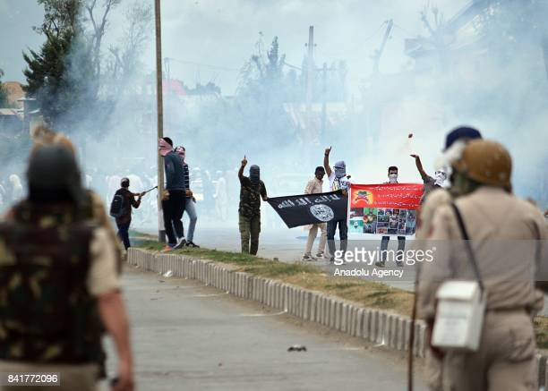 Indian paramilitary soldiers and protesters clash during an antiIndia protest after Eid alAdha prayer in Srinagar the summer capital of Indian...