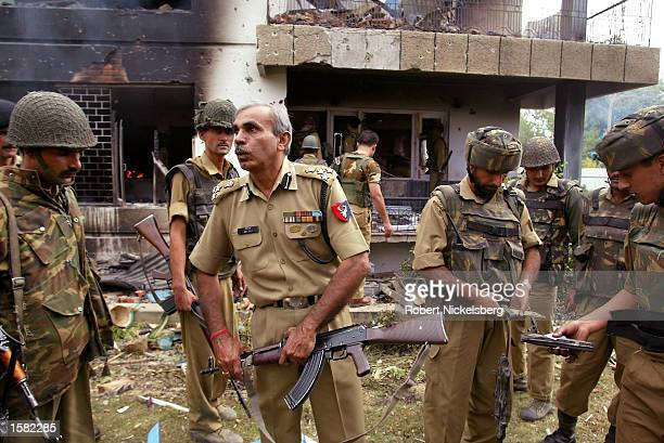 Indian paramilitary soldiers and the main officer incharge Dev Raj of the BSF regroup following the detonation of a large explosive device inside the...