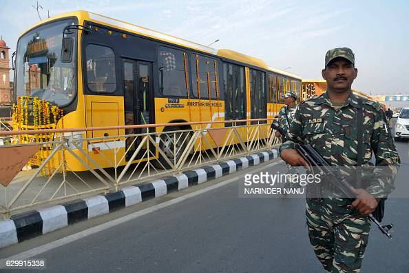 Indian paramilitary soldiers escort a bus during the inauguration ceremony of the first phase of the Bus Rapid Transport System in Amritsar on...
