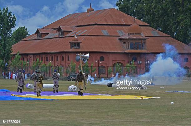 Indian paramilitary soldiers fire teargas shells towards devotees during an antiIndia protest after Eid alAdha prayer in Srinagar the summer capital...