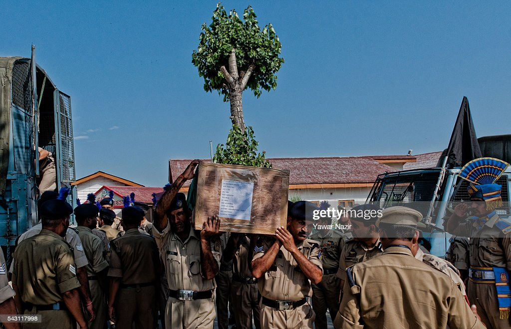 Indian Paramilitary soldiers of Central Reserve Police Force (CRPF) carry the coffins containing bodies of their killed comrades during a wreath-laying ceremony of eight CRPF soldiers killed in an ambush on June 26, 2016 in Srinagar, the summer capital of Indian Administered Kashmir, Indian. Eight Indian Central Reserve Police Force troopers were killed and another twenty critically wounded on Saturday after pro freedom rebels ambushed a paramilitary convoy on the Srinagar-Jammu highway near Pampore in Jammu and Kashmir's Pulwom district, police said. The firing was returned and two rebels were killed in the retaliatory action by the CRPF troopers. A wreath-laying ceremony was held today by the CRPF for their killed comrades.