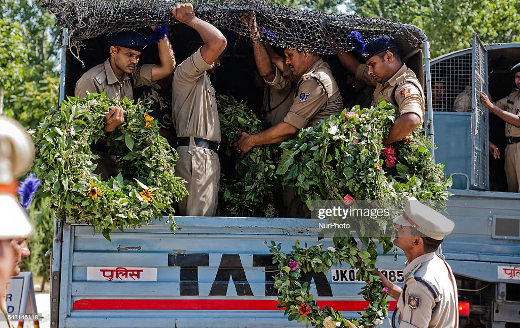 Indian Paramilitary soldiers of Central Reserve Police Force (CRPF) carry wreaths before laying them on the coffins containing bodies of their killed comrades during a wreath-laying ceremony of eight CRPF soldiers killed in an ambush on June 26, 2016 in Srinagar, the summer capital of Indian Administered Kashmir, Indian. The CRPF held a wreath-laying ceremony for eight troopers who were killed yesterday in an ambush by rebels on the Srinagar-Jammu highway in Pampore area of Pulwama district. Two militants were also killed in retaliatory action by the troopers, police said.