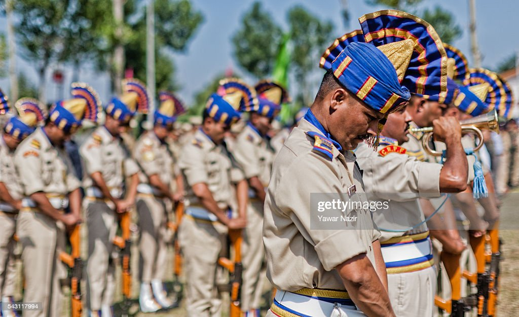 Indian Paramilitary soldiers of Central Reserve Police Force (CRPF) honour their killed comrades during a wreath-laying ceremony of eight CRPF soldiers killed in an ambush on June 26, 2016 in Srinagar, the summer capital of Indian Administered Kashmir, Indian. Eight Indian Central Reserve Police Force troopers were killed and another twenty critically wounded on Saturday after pro freedom rebels ambushed a paramilitary convoy on the Srinagar-Jammu highway near Pampore in Jammu and Kashmir's Pulwom district, police said. The firing was returned and two rebels were killed in the retaliatory action by the CRPF troopers. A wreath-laying ceremony was held today by the CRPF for their killed comrades.