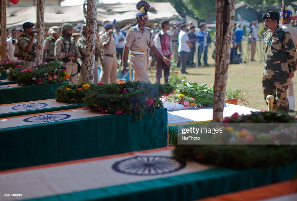 Indian Paramilitary soldiers of Central Reserve Police Force (CRPF) lays wreath on the the coffins containing bodies of their killed comrades during a wreath-laying ceremony of eight CRPF soldiers killed in an ambush on June 26, 2016 in Srinagar, the summer capital of Indian Administered Kashmir, Indian. The CRPF held a wreath-laying ceremony for eight troopers who were killed yesterday in an ambush by rebels on the Srinagar-Jammu highway in Pampore area of Pulwama district. Two militants were also killed in retaliatory action by the troopers, police said.