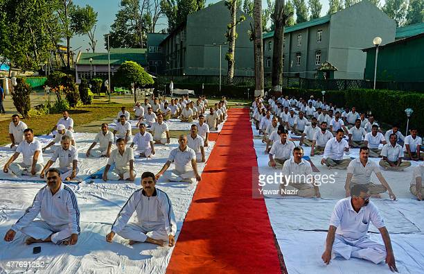 Indian Paramilitary soldiers of Central Reserve Police Force perform Yoga exercise in their camp on June 19 in Srinagar the summer capital of Indian...