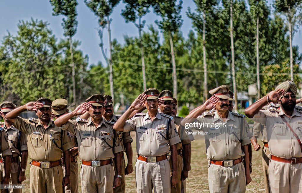 Indian Paramilitary soldiers of Central Reserve Police Force (CRPF) salute and honour their killed comrades during a wreath-laying ceremony of eight CRPF soldiers killed in an ambush on June 26, 2016 in Srinagar, the summer capital of Indian Administered Kashmir, Indian. Eight Indian Central Reserve Police Force troopers were killed and another twenty critically wounded on Saturday after pro freedom rebels ambushed a paramilitary convoy on the Srinagar-Jammu highway near Pampore in Jammu and Kashmir's Pulwom district, police said. The firing was returned and two rebels were killed in the retaliatory action by the CRPF troopers. A wreath-laying ceremony was held today by the CRPF for their killed comrades.