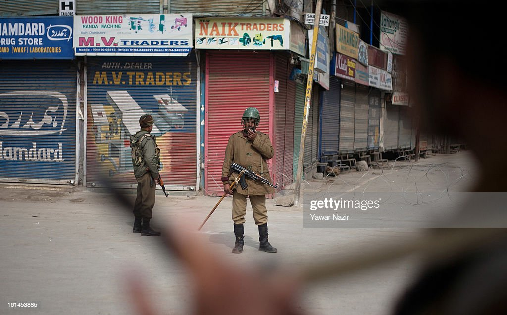 Indian paramilitary soldiers patrol deserted streets during a curfew, imposed after the execution of alleged Indian parliament attacker Mohammad Afzal Guru on February 11, 2013 in Srinagar, the summer capital of Indian Administered Kashmir, India. Afzal Guru, from Sopore town in the north of Kashmir, was hung on February 09 for his role in the 2001 Indian parliament attack which left 14 dead. The hanging has further strained relations between India - who blamed the attack on 'Pakistan backed' militant group Jaish-e-Mohammed - and neighbouring Pakistan and has seen an military increase from both along the border.