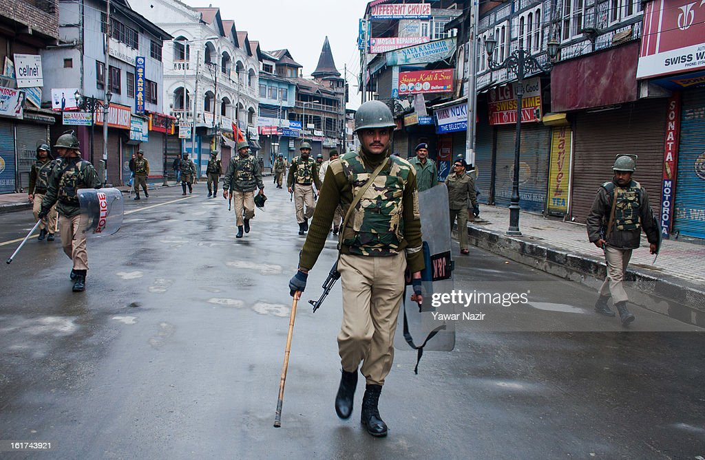 Indian paramilitary soldiers patrol streets in main city during a strict curfew on the seventh consecutive day, imposed after the execution of alleged Indian parliament attacker Mohammad Afzal Guru on February 15, 2013 in Srinagar, the summer capital of Indian Administered Kashmir, India. Afzal Guru, from Sopore town in the north of Kashmir, was hung on February 09 for his role in the 2001 Indian parliament attack which left 14 dead. The hanging has further strained relations between India - who blamed the attack on 'Pakistan backed' militant group Jaish-e-Mohammed - and neighbouring Pakistan and has seen an military increase from both along the border.Curfew was lifted from some parts of Srinagar after four days.