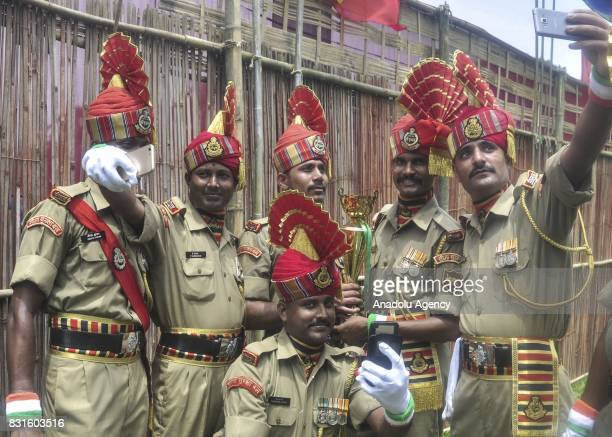 Indian paramilitary soldiers pose for a photo after the military parade during Indian Independence Day celebrations in Agartala India on August 15...