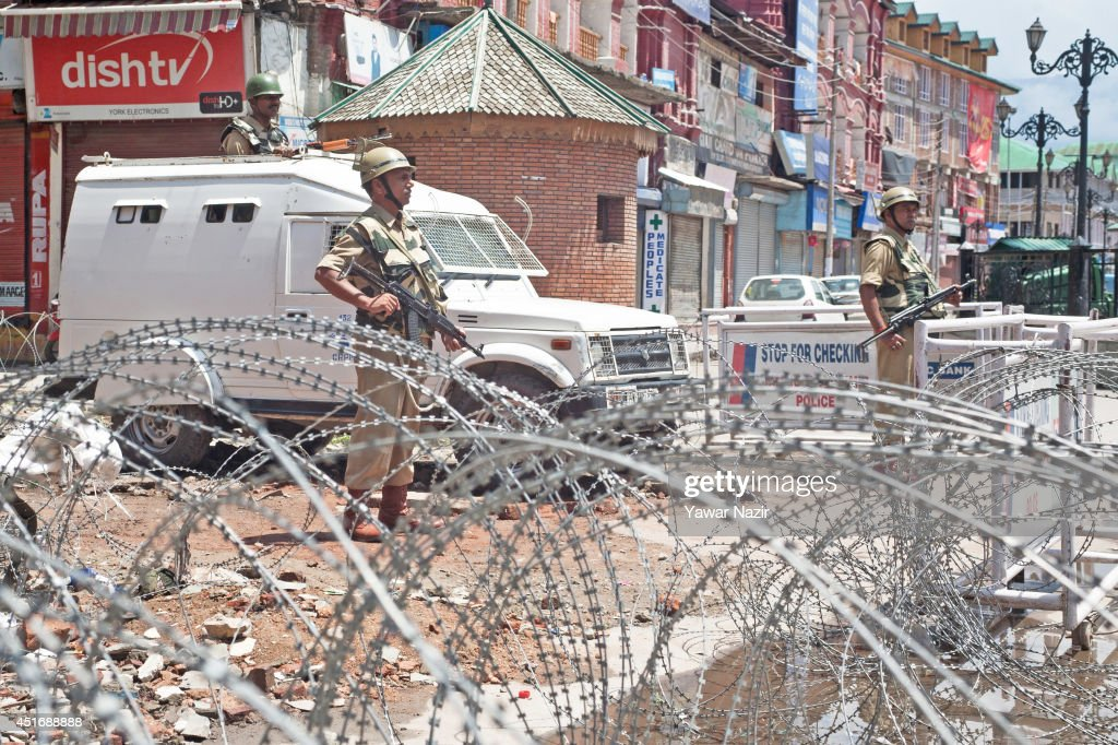 Indian paramilitary soldiers stand guard in the city centre during a strike against Indian Prime Minister Narendra Modi's visit on July 4, 2014, in Srinagar,the summer capital of Indian administered Kashmir, India. India's newly elected leader, Prime Minister Narendra Modi made his first official trip to Indian-controlled Kashmir, India's only Muslim-majority state, where separatist groups called a strike that closed down shops, businesses, schools, and all traffic. Disputes arose from Prime Minister Narendra Modi's inauguration of a railway line and a plan to review security and development in the Himalayan region dividing India and Pakistan. Reports stated that the restrictions were imposed to prevent any violent protests by separatist groups who oppose Indian rule.