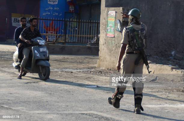 Indian paramilitary troopers check up on commuters during a curfew in downtown Srinagar Authorities imposed a curfew in Srinagar as violence spread...